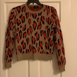 Cropped tan with red and black sweater